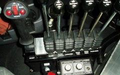 Joystick and Six Control Levers by .